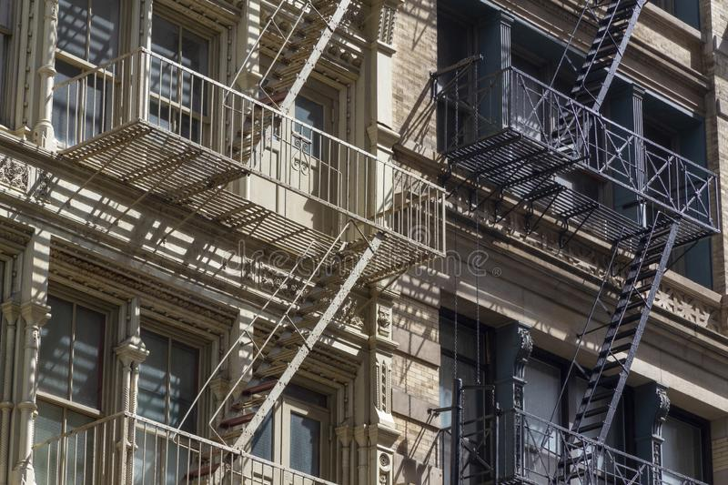 Fire escape stairs-downtown back alley architecture-steel and red brick background. New York Fire escape stairs-downtown back alley architecture-steel and red royalty free stock image