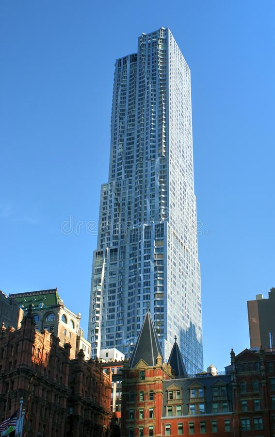 New York by Gehry Tower. Also known as Beekman Tower, is one of the tallest residential buildings in New York City. Located at 8 Spruce Street stock photography