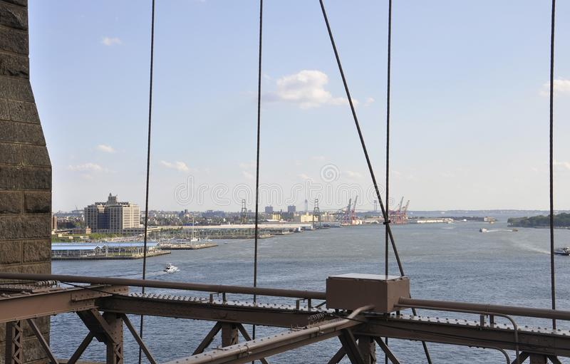 New York Harbor view from Brooklyn Bridge over East River of Manhattan from New York City in United States. On 3rd july 2017 stock photos