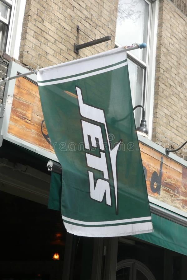New York Jets Flag. A NY Jets flag in downtown Manhattan. The New York Jets are a professional American football team located in the New York metropolitan area royalty free stock images