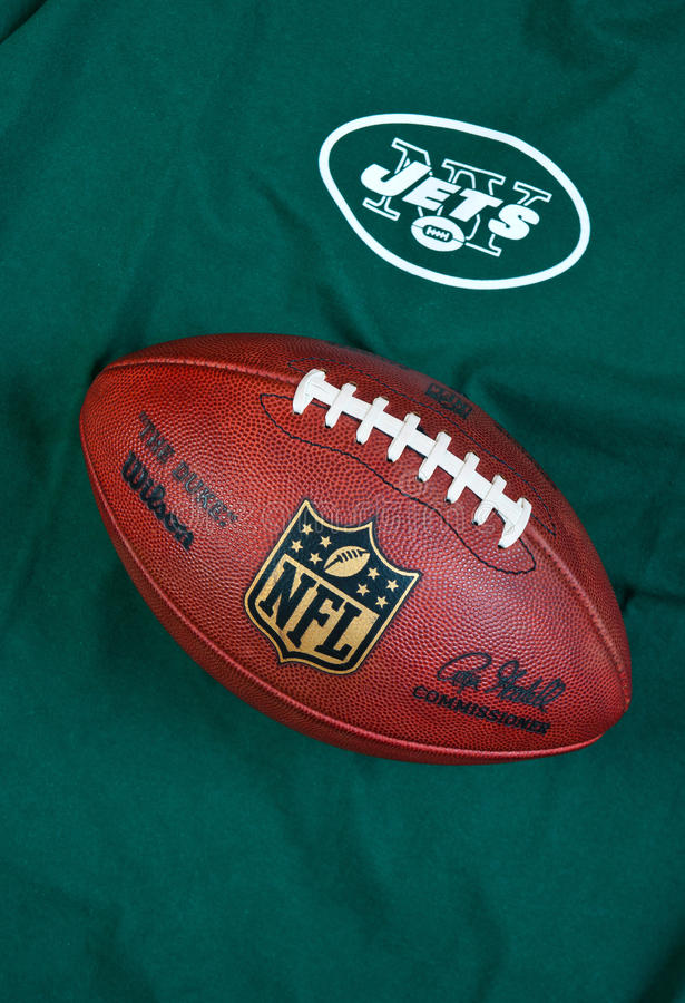 New york jets. ZAGREB , CROATIA - FEBRUARY 14, 2014 : NFL New York Jets club equipment with NFL official ball, product shot royalty free stock photos