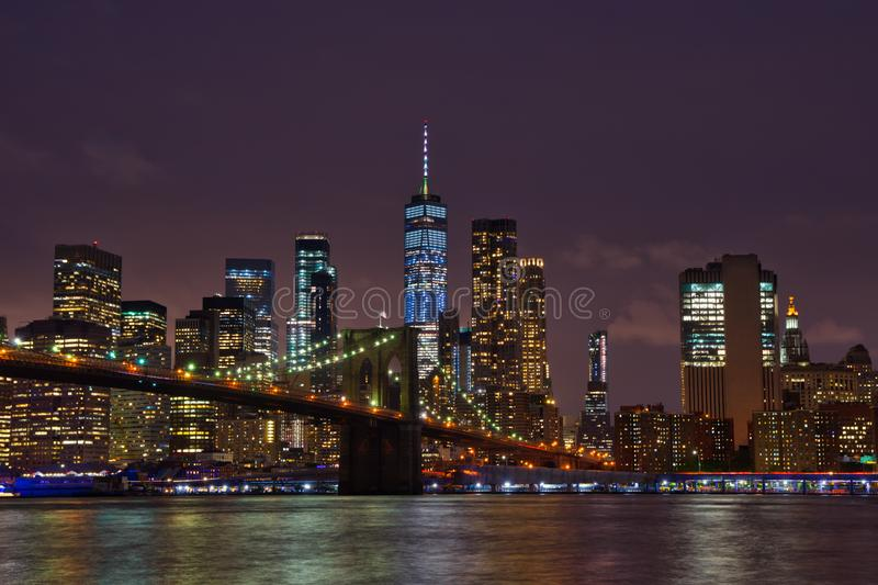 New York Manhattan skyline and Brooklyn Bridge by night stock image