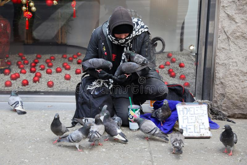 Homeless man at 5th Avenue in Midtown Manhattan. NEW YORK - MARCH 7, 2019: Homeless man at 5th Avenue in Midtown Manhattan royalty free stock photography