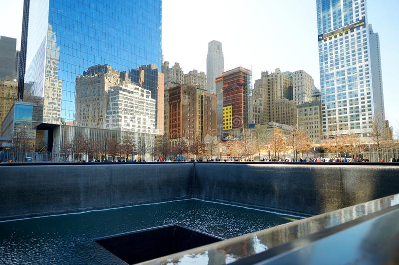 NEW YORK - MARCH 21, 2015: The South Pool of the National September 11 Memorial adjacent to One World Trade Center in Lower Manhat. Tan, New York City, USA stock image