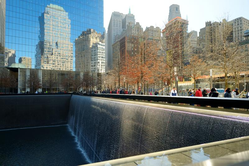 NEW YORK - MARCH 21, 2015: The South Pool of the National September 11 Memorial adjacent to One World Trade Center in Lower Manhat. Tan, New York City, USA stock photography