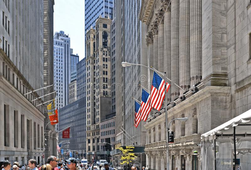 New York, Wall Street stock exchange with classic columns and old architecture and colorful flags of united states of. New York, 20 may 2016. Wall Street stock royalty free stock photography