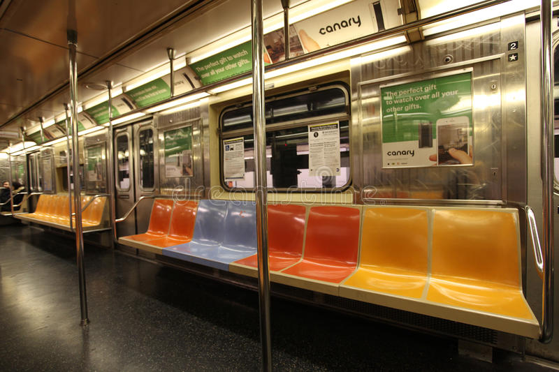 New York metro train, USA. Colorful seats inside New York metro train, United States of America, USA. December 2015 stock photography