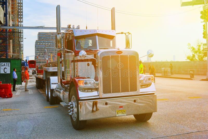 New York. Midtown district. Large American truck trucker. New York, USA- September 06, 2017 : Urban cityscape of New York. Midtown district. Large American royalty free stock photo