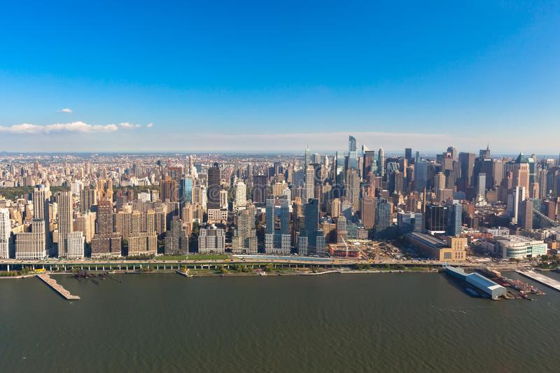 New York Midtown Manhattan in NYC NY in USA. Aerial helicopter view. Skyscrapers and Central Park on the background of the Hudson Bay at sunset royalty free stock image