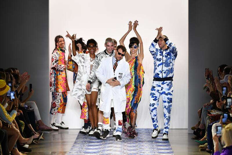 Designer Johnson Hartig and models walks the runway for Libertine during New York Fashion Week. NEW YORK, NEW YORK - SEPTEMBER 11: Designer Johnson Hartig and stock images