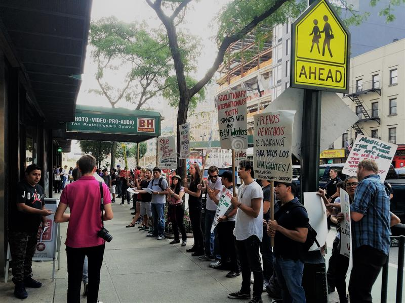 People outside B&H Photo store in Manhattan protesting with signs calling for termination of union-busting in the hands stock photos