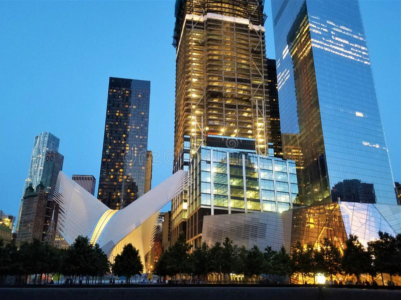 World Trade Center station WTC Transportation Hub Westfield, Oculus and Museum 9/11, skyscrapers behind. Manhattan. Night view royalty free stock photo