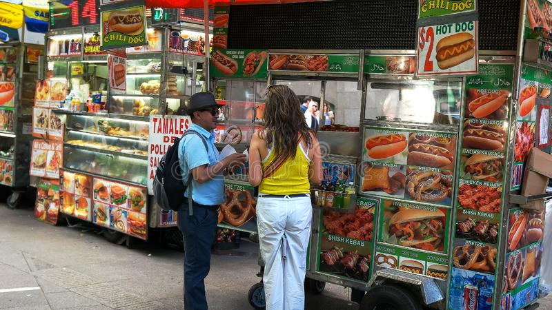 NEW YORK, NEW YORK, USA - SEPTEMBER 15, 2015: customers buying food from a food truck, new york royalty free stock photo