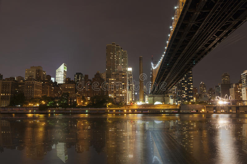 New York by night - Midtown of Manhattan. And Queensborough Bridge - taken from Roosevelt Island stock images