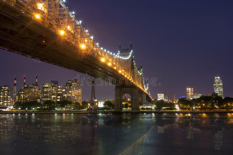 New York by night - Midtown of Manhattan. And Queensborough Bridge - taken from Roosevelt Island royalty free stock photography
