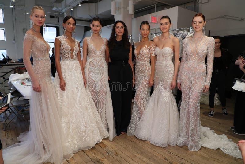 Designer Berta Balilti and models posing backstage before the Berta Bridal Spring 2019 Fashion show. NEW YORK, NY - APRIL 13: Designer Berta Balilti and models royalty free stock images