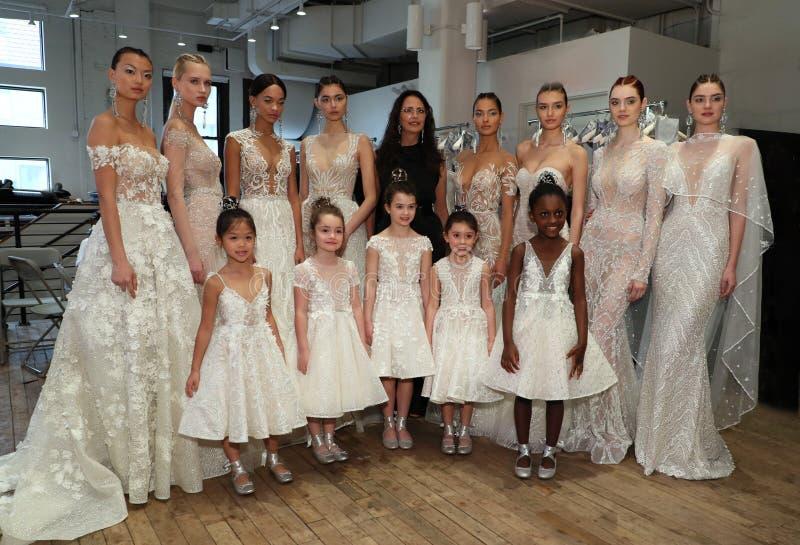 Designer Berta Balilti and models posing backstage before the Berta Bridal Spring 2019 Fashion show. NEW YORK, NY - APRIL 13: Designer Berta Balilti and models stock photos