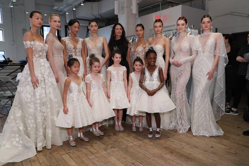 Designer Berta Balilti and models posing backstage before the Berta Bridal Spring 2019 Fashion show. NEW YORK, NY - APRIL 13: Designer Berta Balilti and models royalty free stock photo