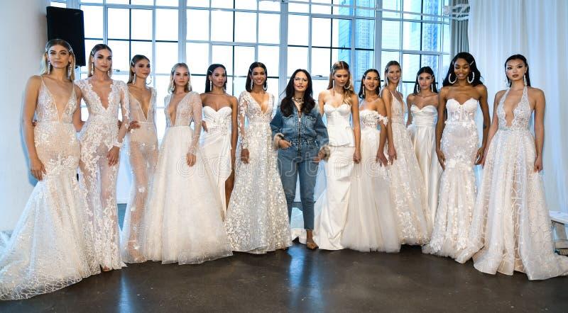 Designer Berta Balilti and models posing backstage before the Berta Bridal Spring 2020 fashion show. NEW YORK, NY - APRIL 12: Designer Berta Balilti and models royalty free stock images