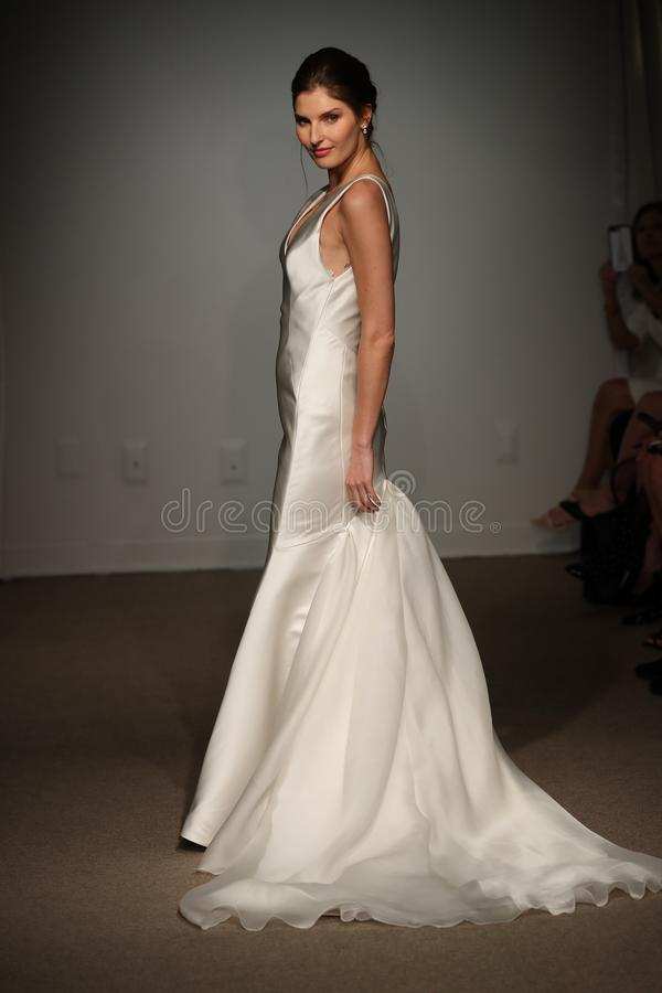 A model walks the runway during the Anna Maier / Ulla-Maija Spring 2019 Bridal fashion show royalty free stock photography