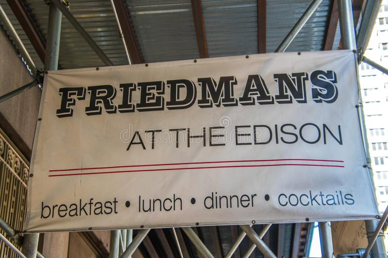 Sign on scaffolding at construction site at front entrance of Friedman`s Restaurant at the Edison Hotel on 47th Street in stock image