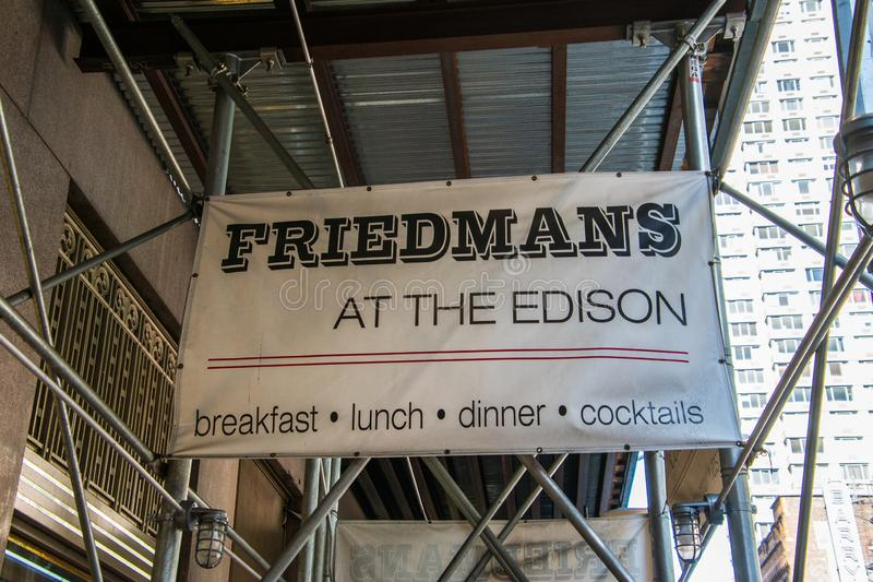 Sign on scaffolding at construction site at front entrance of Friedman`s Restaurant at the Edison Hotel on 47th Street in stock photography