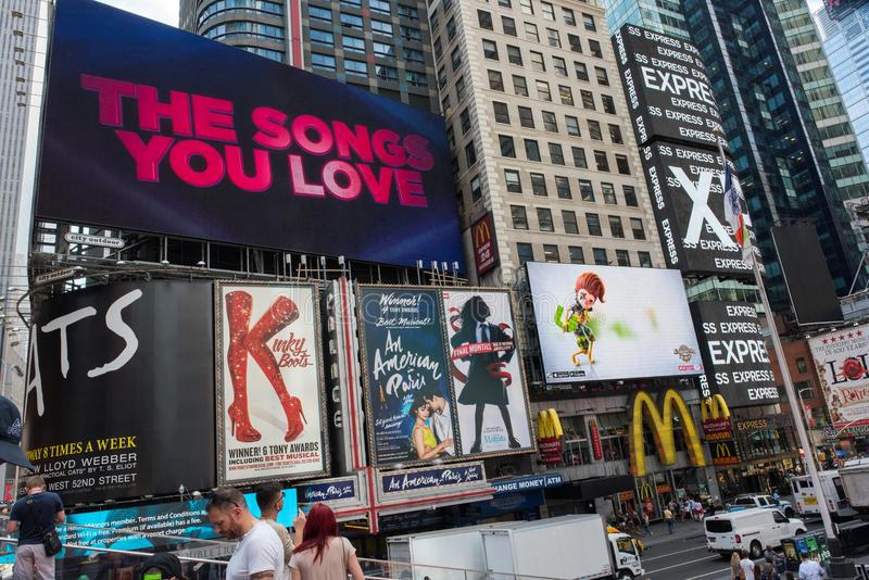 Times Square, New York City. New York, NY: August 28, 2016: New York Times Square large LED signs/billboards. On an average day, 360,000 people visit Times royalty free stock photo