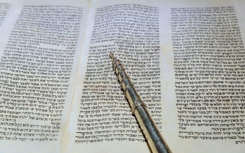 NEW YORK NY March 2019. Hebrew religious Torah old scroll book parchment. NEW YORK NY March 2019. Hebrew religious Torah parchment old scroll book, simchat royalty free stock image