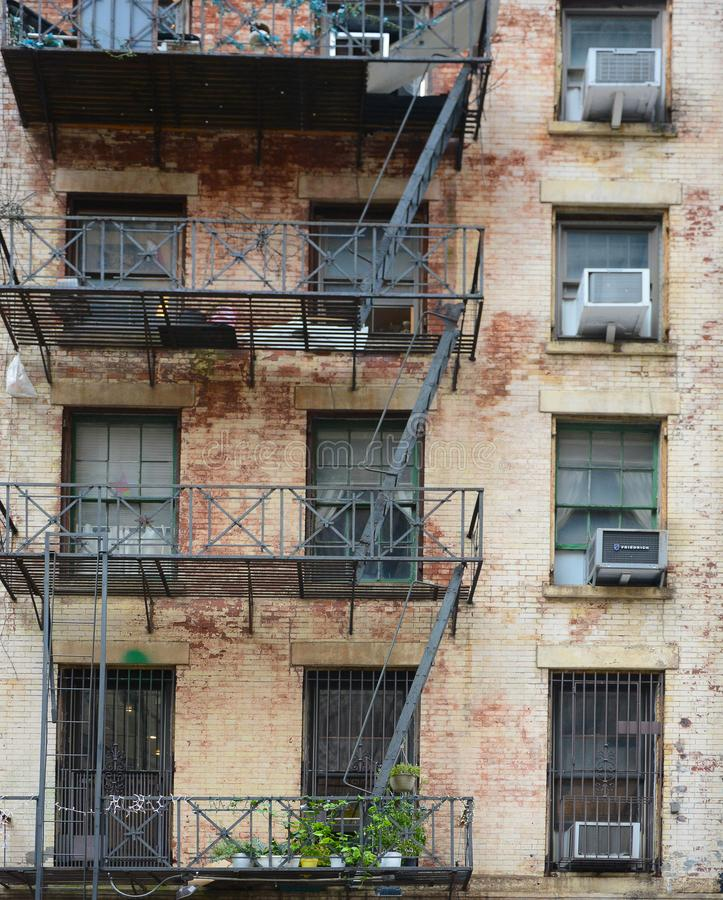 Detail closeup of an old building and fire escape in lower Manhattan royalty free stock photography