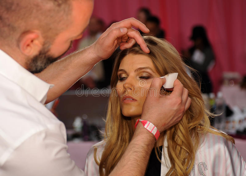 NEW YORK, NY - NOVEMBER 13: Makeup Artist Page applying make-up to Maryna Linchuk at the 2013 Victoria s Secret Fashion Show