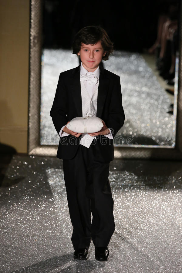 NEW YORK, NY - OCTOBER 09: A child model walks the runway wearing Oleg Cassini Fall 2015 Bridal collection. At the Plaza Athenee on October 09, 2014 in New York stock photo