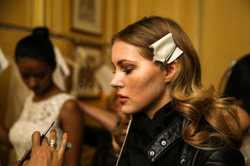 NEW YORK, NY - OCTOBER 09: A model getting ready backstage during Oleg Cassini Fall 2015 Bridal collection stock photography