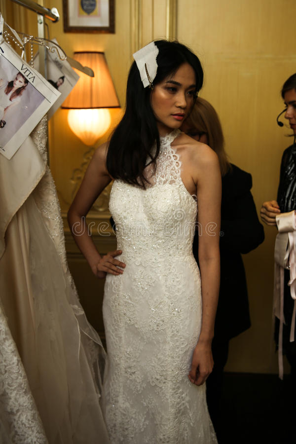 NEW YORK, NY - OCTOBER 09: A model getting ready backstage wearing Oleg Cassini Fall 2015 Bridal collection. At the Plaza Athenee on October 09, 2014 in New stock photography