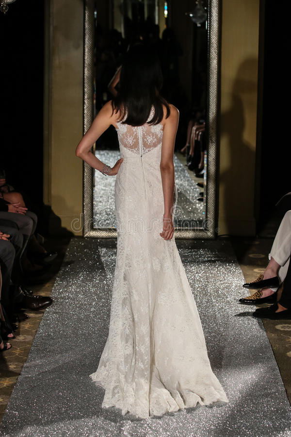 NEW YORK, NY - OCTOBER 09: A model walks the runway wearing Oleg Cassini Fall 2015 Bridal collection. At the Plaza Athenee on October 09, 2014 in New York City stock photo