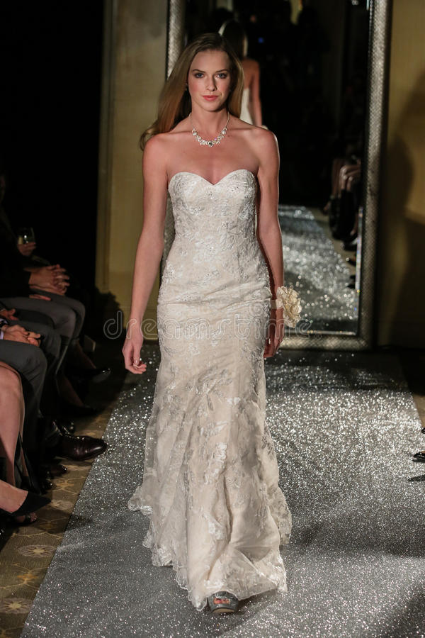 NEW YORK, NY - OCTOBER 09: A model walks the runway wearing Oleg Cassini Fall 2015 Bridal collection. At the Plaza Athenee on October 09, 2014 in New York City stock photos