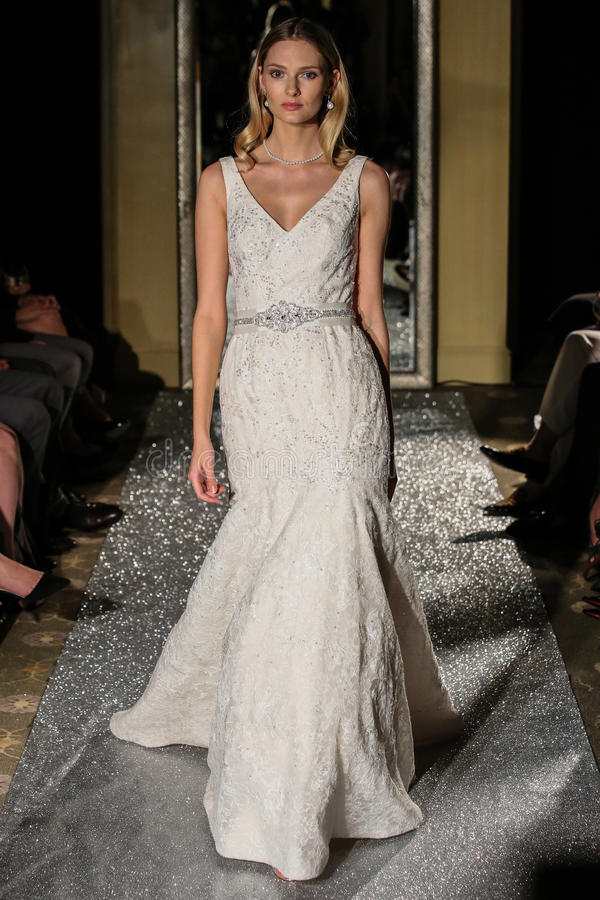 NEW YORK, NY - OCTOBER 09: A model walks the runway wearing Oleg Cassini Fall 2015 Bridal collection. At the Plaza Athenee on October 09, 2014 in New York City stock images