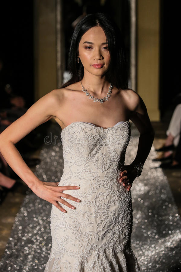 NEW YORK, NY - OCTOBER 09: A model walks the runway wearing Oleg Cassini Fall 2015 Bridal collection. At the Plaza Athenee on October 09, 2014 in New York City royalty free stock photos