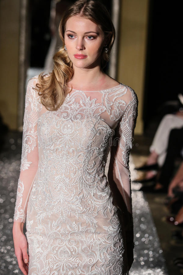 NEW YORK, NY - OCTOBER 09: A model walks the runway wearing Oleg Cassini Fall 2015 Bridal collection. At the Plaza Athenee on October 09, 2014 in New York City royalty free stock images