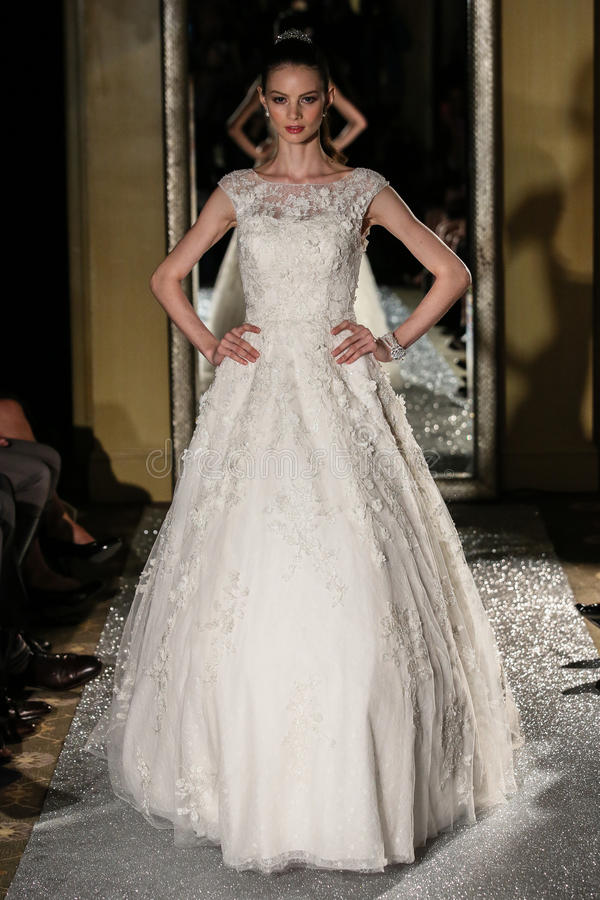 NEW YORK, NY - OCTOBER 09: A model walks the runway wearing Oleg Cassini Fall 2015 Bridal collection. At the Plaza Athenee on October 09, 2014 in New York City stock photography
