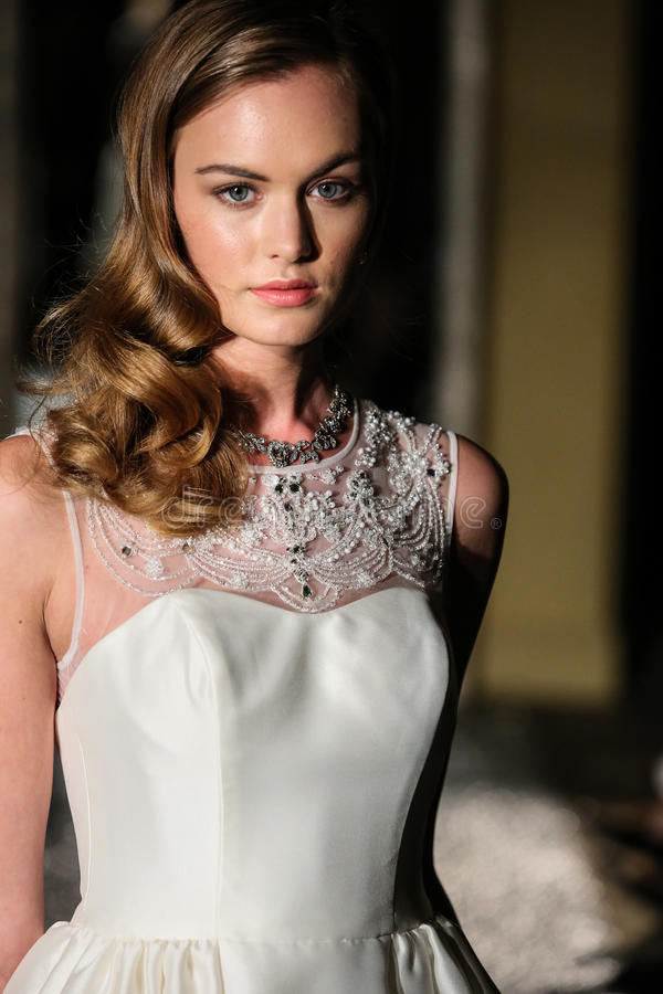NEW YORK, NY - OCTOBER 09: A model walks the runway wearing Oleg Cassini Fall 2015 Bridal collection. At the Plaza Athenee on October 09, 2014 in New York City royalty free stock image