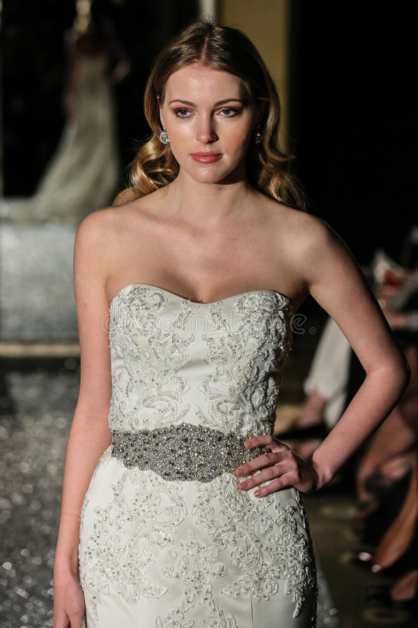 NEW YORK, NY - OCTOBER 09: A model walks the runway wearing Oleg Cassini Fall 2015 Bridal collection. At the Plaza Athenee on October 09, 2014 in New York City stock image