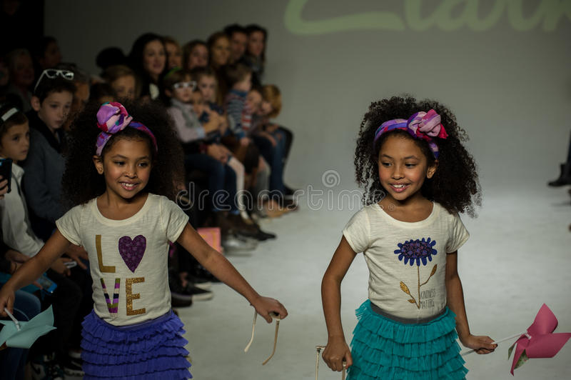 NEW YORK, NY - OCTOBER 19: Models walk the runway during the Clarks preview. At petitePARADE Kids Fashion Week at Bathhouse Studios on October 19, 2014 in New stock photography