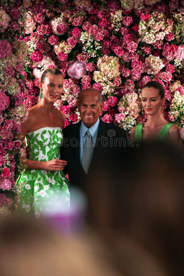NEW YORK, NY - SEPTEMBER 09: Designer Oscar de la Renta (C) and model Karlie Kloss (L) walk the runway stock photos