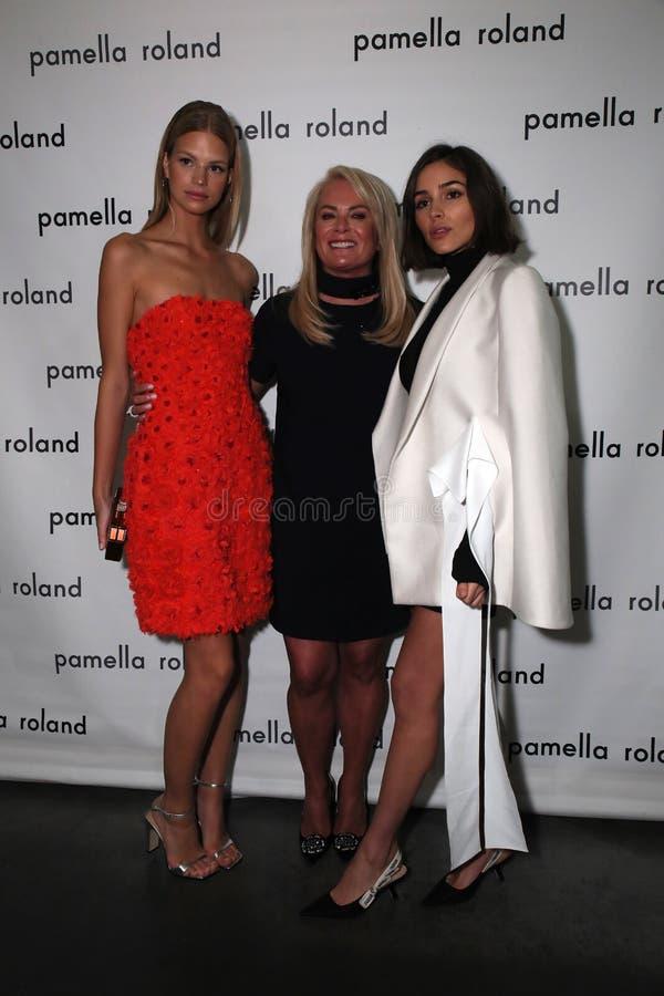 Model Nadine Leopold, designer Pamella Roland and actress Olivia Culpo pose backstage. NEW YORK, NY - SEPTEMBER 06: L-R Model Nadine Leopold, designer Pamella royalty free stock photo