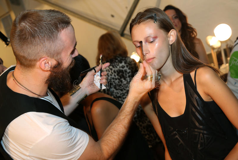 NEW YORK, NY - SEPTEMBER 06: A model has her make-up done backstage at Venexiana stock photography