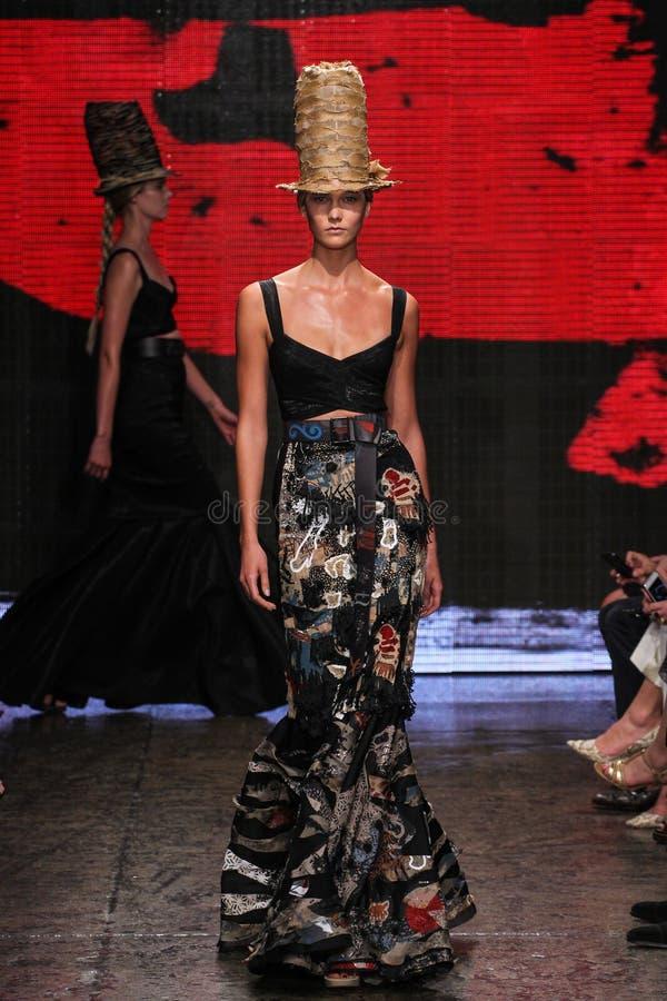 NEW YORK, NY - SEPTEMBER 08: Model Karlie Kloss walks the runway at Donna Karan Spring 2015 collection stock photos