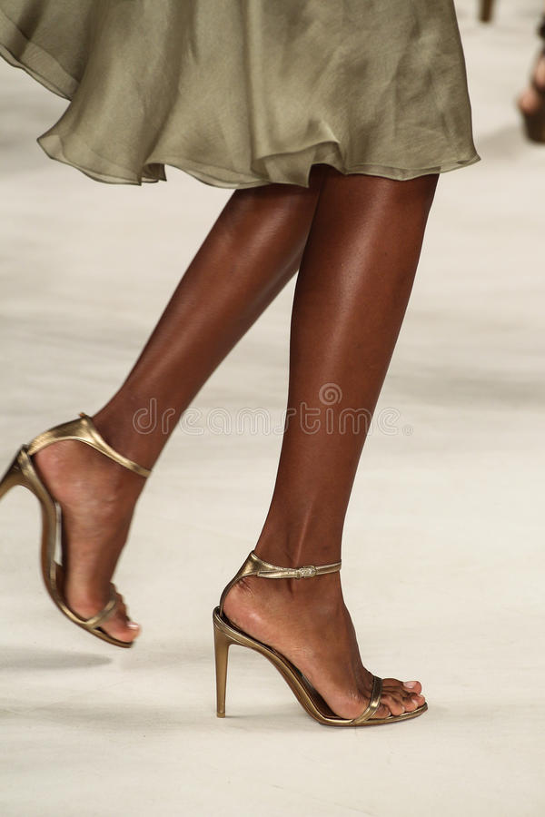 NEW YORK, NY - SEPTEMBER 11: A model walks the runway at Ralph Lauren Spring 2015 fashion collection stock photo