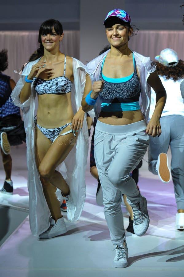 NEW YORK, NY - SEPTEMBER 03: Models perform during the Athleta Runway show royalty free stock image