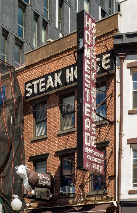 New York, NY / United States - July 19, 2016: Vertical shot of New York City's oldest and famous Homestead Steakhouse. Portrait shot of the famous steak house & royalty free stock photos
