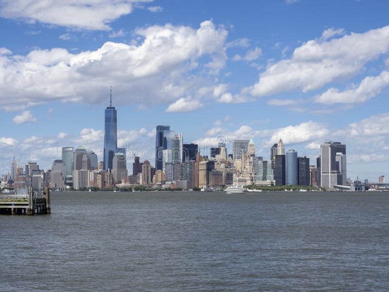 New York, NY, USA. Amazing skyline of Manhattan skyscrapers from Liberty Island - Statue of Liberty. Summer time stock photography